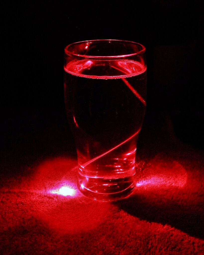 Pint glass with red laser.